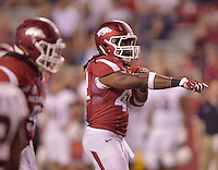 STAFF PHOTO BEN GOFF  @NWABenGoff -- 09/20/14 <br /> Arkansas middle linebacker Josh Williams directs the defense during the fourth quarter of the game against Northern Illinois in Reynolds Razorback Stadium in Fayetteville on Saturday September 20, 2014.