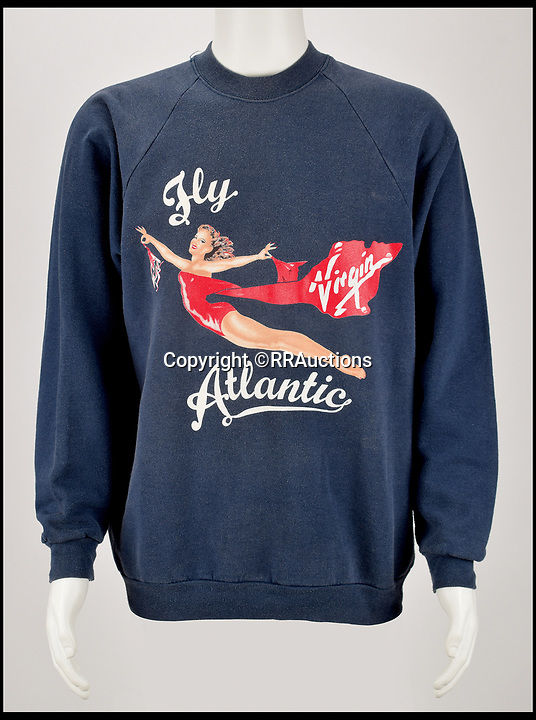 BNPS.co.uk (01202 558833)Pic:    RRAuctions/BNPS<br /> <br /> Princess Diana's favourite gym sweatshirt which was a gift from businessman Sir Richard Branson has emerged for sale for £4,000. ($5,000)<br /> <br /> She was regularly snapped wearing the dark blue cotton top with the Virgin Lady 'Flying Lady' logo when leaving the exclusive Harbour Club gym in Chelsea.<br /> <br /> Diana gifted the casual item of clothing to her longtime personal trainer, Jenni Rivett, months before her death 22 years ago.<br /> <br /> Accompanied with it was a note which read 'Dearest Jenni, Lots of love from, Diana, x'.