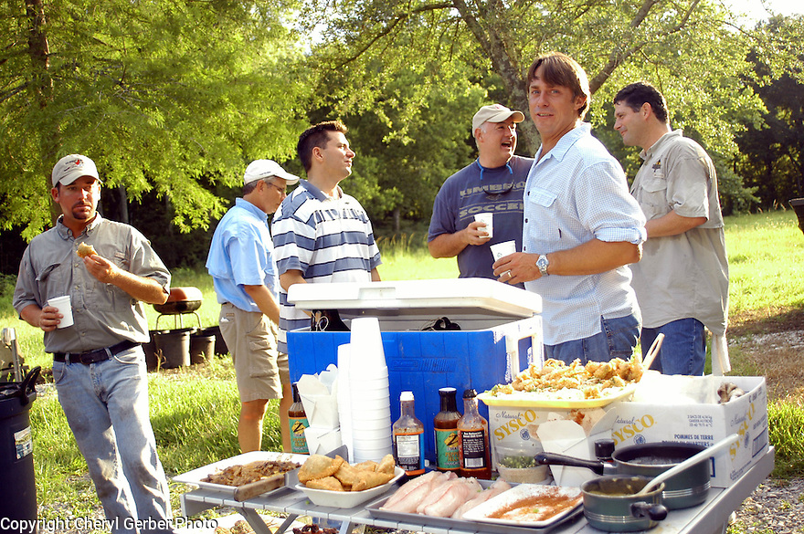 Nash Roberts, Justin Frey, Randy Pierce, Jeff Tunks, John Besh, and Greg Reggio gathered for outdoor cookout before frog hunt, June 29, 2005..(Cheryl Gerber Photo)