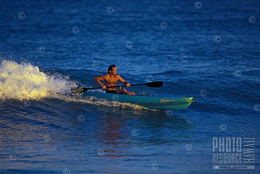 Man riding wave in a kayak