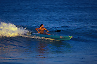Man riding wave in a kayak