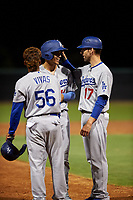 AZL Dodgers Lasorda Jaime Perez (14) is congratulated by Jorbit Vivas (56) and manager Danny Dorn (17) after hitting a double during an Arizona League game against the AZL White Sox at Camelback Ranch on June 18, 2019 in Glendale, Arizona. AZL Dodgers Lasorda defeated AZL White Sox 7-3. (Zachary Lucy/Four Seam Images)