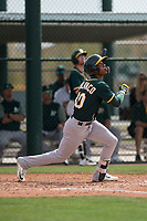 Oakland Athletics center fielder Dairon Blanco (30) follows through on his swing during a Minor League Spring Training game against the Chicago Cubs at Sloan Park on March 13, 2018 in Mesa, Arizona. (Zachary Lucy/Four Seam Images)