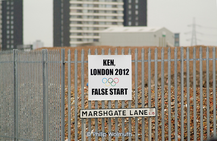 Protest posters on the fence surrounding contaminated land being cleared for a new Aquatic Centre at Stratford, East London, proposed site of the 2012 Olympics. Employees of some of the many local businesses are concerned that they may lose their jobs if firms are forced to relocate out of the area.