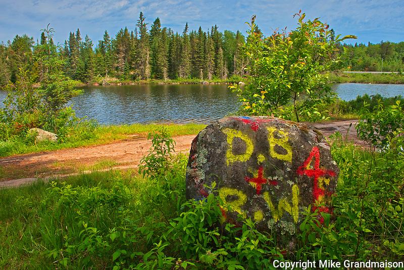 Graffiti or defacing of the natural environment at Graphic Lake<br />Kenora DIstrict<br />Ontario<br />Canada