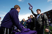 Northwestern freshmen receive t-shirts and foam fingers in Wildcat Alley before the game against South Dakota.