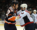 Dec 16, 2008; Uniondale, NY, USA; Washington Capitals rightwing Matt Bradley (10) battles with New York Islander rightwing Tim Jackman (28) during game at the Nassau Coliseum.Capitals won 5-4 in OT. Mandatory Credit: Tomasso DeRosa/SportPics