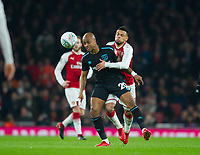 West Ham's Andre Ayew and Arsenal's Francis Coquelin during the Carabao Cup QF match between Arsenal and West Ham United at the Emirates Stadium, London, England on 19 December 2017. Photo by Andrew Aleksiejczuk / PRiME Media Images.