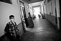 A Tuberculosis patient with his face covered is seen at the Rajan babu hospital in New Delhi, India.