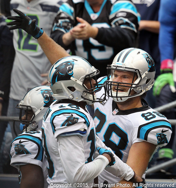 Carolina Panthers tight end Greg Olsen (88) celebrates with Corey Brown (10)  at CenturyLink Field in Seattle on October 18, 2015 after catching the winning touchdown against the Seattle Seahawks. The Panthers came from behind with 32 seconds remaining in the 4th Quarter to beat the Seahawks 27-23.  ©2015 Jim Bryant Photography. All Rights Reserved.