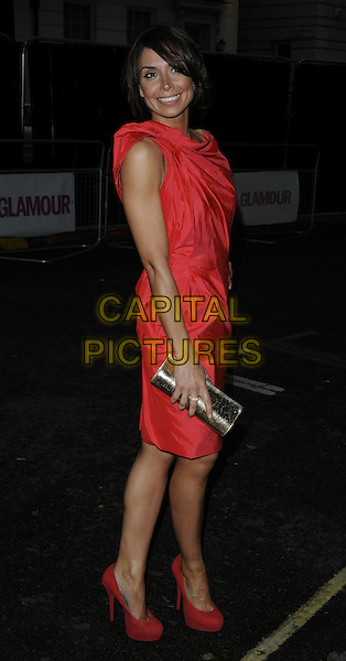 CHRISTINE BLEAKLEY .Glamour Women Of The Year Awards - Outside Arrivals, Berkeley Square Gardens, London, England, UK, .June 8th 2010. .full length red dress side platform suede shoes .CAP/CAN.©Can Nguyen/Capital Pictures.