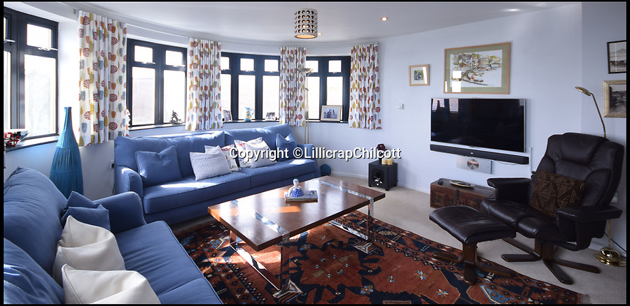 """BNPS.co.uk (01202 558833)Pic: LillicrapChilcott/BNPS<br /> <br /> Room with a (360) view...<br /> <br /> This striking £1.15m Art Deco style house that has some of the best views in Cornwall comes with an extra surprise - a spinning roof pod that offers 360-degree views.<br /> <br /> The stunning Spinnakers in Marazion, Cornwall's oldest town, sits in an elevated position overlooking the beautiful Mount's Bay and the hugely popular tourist attraction St Michael's Mount, with panoramic views from most of the rooms.<br /> <br /> But the real wow factor comes from the unparalleled vistas the new owners will be able to soak up from the roof terrace and a rotating pod room that allows them to enjoy the view even in bad weather.<br /> <br /> The house is now on the market with estate agents Lillicrap Chilcott, who describe the outlook as """"truly mesmerising""""."""