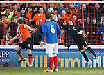 Jon Daly scores with a header past Neil Alexander for Dundee Utd's second goal