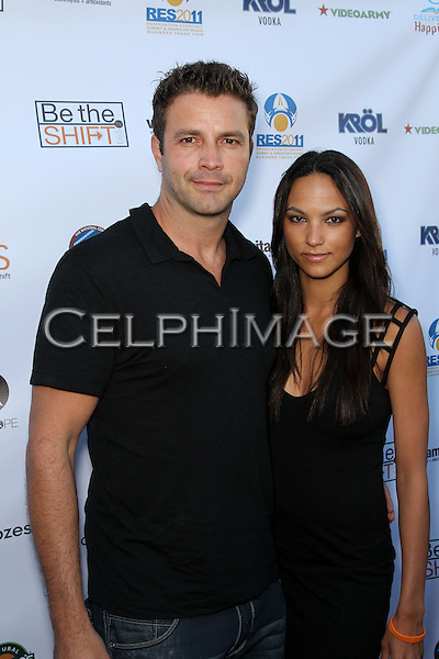 TONY SCHIENA, BIANCA CHRISTIANS. Red Carpet arrivals to the launch event of Be The Shift at Industry Night Club. West Hollywood, CA, USA. 6/14/2010..