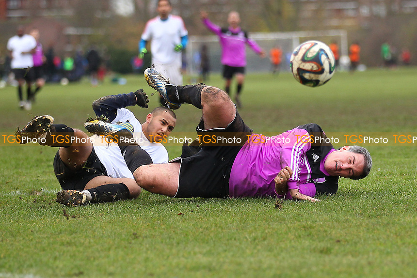 FC Haggerston concede a penalty - RL United (purple) vs FC Haggerston - Hackney & Leyton Sunday League Dickie Davies Cup Football at South Marsh, Hackney Marshes, London - 07/12/14 - MANDATORY CREDIT: Gavin Ellis/TGSPHOTO - Self billing applies where appropriate - 0845 094 6026 - contact@tgsphoto.co.uk - NO UNPAID USE