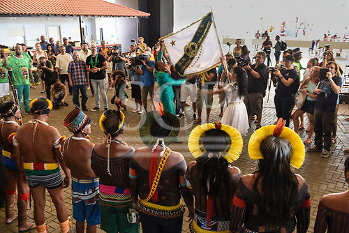 Rio de Janeiro, Brazil. Imperatriz Leopoldinense samba school; preparations for carnival. Indians from the Xingu watch as the Imperatriz Leopoldinense standard bearers prepare to present the standard flag.