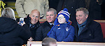 A young fan gets a picture taken with Kenny, Ian and Ally McCoist