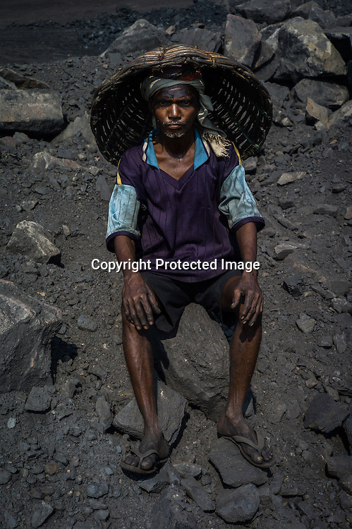 Ramchander Ghuijan, a daily wage labourer poses for a portrait in Goladi coal depot in Jharia, outside of Dhanbad in Jharkhand, India.  Photo: Sanjit Das/Panos