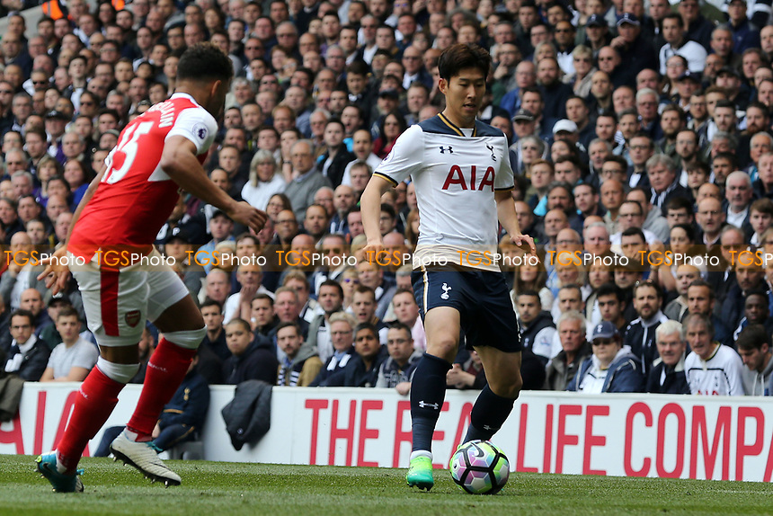 Son Heung-Min of Tottenham Hotspur and Alex Oxlade-Chamberlain of Arsenal during Tottenham Hotspur vs Arsenal, Premier League Football at White Hart Lane on 30th April 2017