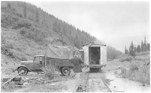 Rear view of Goose #7 blocked by a washin with the Mail truck backed up to transfer mail.  Bill Moedinger is standing while taking a picture of the scene.<br /> RGS  Brown, CO  Taken by Lunoe, Bob - maybe 7/11 7/12/1941
