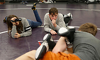 NWA Democrat-Gazette/DAVID GOTTSCHALK Abby Fimbres (left), a ninth grade student at Fayetteville High School, and Jonathon Givens, a sophomore, shoot video of a wrestling practice Wednesday, February 28, 2018, during their Fundamentals of Television class at the high school. The challenge of some businesses, oftentimes blue collar employers, finding qualified workers has prompted several school districts to create workforce training programs.