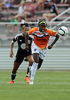 BOYDS, MARYLAND - July 22, 2012:  Lianne Sanderson (10) of DC United Women loses the ball to Sabbath McKiernan Allen (15) of the Charlotte Lady Eagles during the W League Eastern Conference Championship match at Maryland Soccerplex, in Boyds, Maryland on July 22. DC United Women won 3-0.