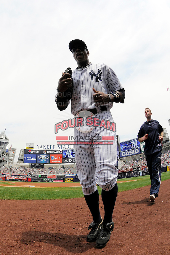 New York Yankees outfielder Curtis Granderson #14 during a game against the Texas Rangers at Yankee Stadium on June 16, 2011 in Bronx, NY.  Yankees defeated Rangers 3-2.  Tomasso DeRosa/Four Seam Images