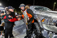 Pete Kaiser accepts his winner's truck from Chuck Talskey of Anchorage Chrysler Dodge at the Nome finish line after winning the 2019 Iditarod Trail Sled Dog Race. Pete's winning time is 9 days 12 hours 39 minutes and 6 seconds<br /> <br /> Photo by Jeff Schultz/  (C) 2019  ALL RIGHTS RESERVED