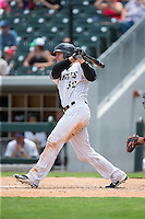 Kevan Smith (32) of the Charlotte Knights follows through on his swing against the Gwinnett Braves at BB&T BallPark on July 3, 2015 in Charlotte, North Carolina.  The Braves defeated the Knights 11-4 in game one of a day-night double header.  (Brian Westerholt/Four Seam Images)
