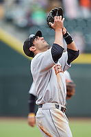 Frederick Keys third baseman Jason Esposito (11) settles under a pop fly during the game against the Winston-Salem Dash at BB&T Ballpark on May 18, 2014 in Winston-Salem, North Carolina.  The Dash defeated the Keys 7-6.  (Brian Westerholt/Four Seam Images)