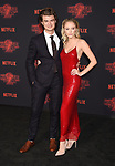 WESTWOOD, CA - OCTOBER 26: Actor Joe Keery (L) and actress Maika Monroe arrive at the Premiere Of Netflix's 'Stranger Things' Season 2 at Regency Westwood Village Theatre on October 26, 2017 in Los Angeles, California.