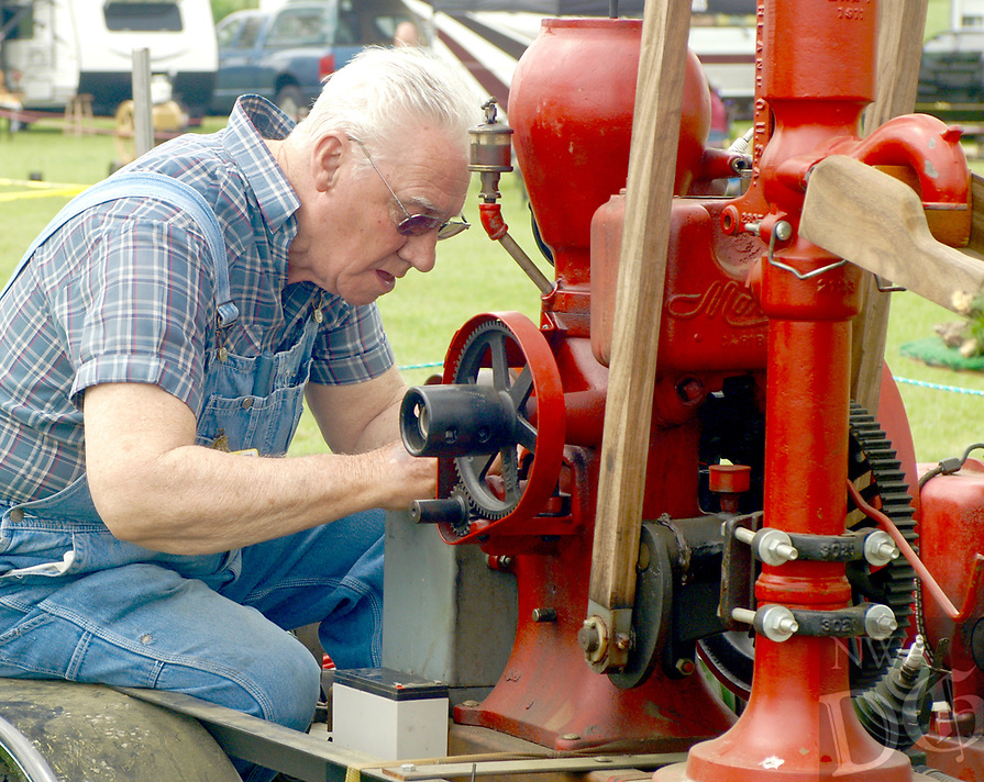 Photo by Randy Moll<br /> Robert Swanson of West Fork works on his 1 1/4 HP hit and miss engine on Friday (April 14, 2017) at the Tired Iron of the Ozarks show in Gentry.