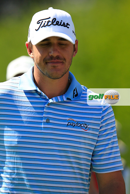 Brooks KOEPKA (USA) walks off the 9th tee during Saturday's Round 3 of the 2014 Omega European Masters held at the Crans Montana Golf Club, Crans-sur-Sierre, Switzerland.: Picture Eoin Clarke, www.golffile.ie: 6th September 2014
