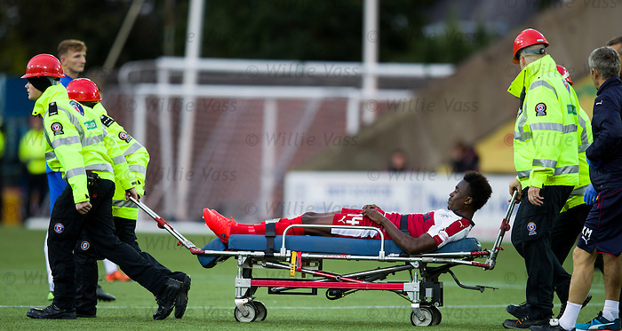 Joe Dodoo stretchered off