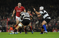 Wales Jarrod Evans is tackled by Barbarians Tyler Ardron<br /> <br /> Photographer Ian Cook/CameraSport<br /> <br /> 2019 Autumn Internationals - Wales v Barbarians - Saturday 30th November 2019 - Principality Stadium - Cardifff<br /> <br /> World Copyright © 2019 CameraSport. All rights reserved. 43 Linden Ave. Countesthorpe. Leicester. England. LE8 5PG - Tel: +44 (0) 116 277 4147 - admin@camerasport.com - www.camerasport.com
