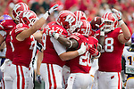 Wisconsin Badgers running back James White (20) celebrates a touchdown with teammates during an NCAA football game against the Tennessee Tech Golden Eagles  Saturday, September 7, 2013, in Madison, Wis. (Photo by David Stluka)