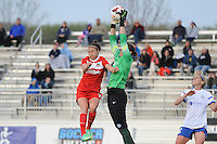 Boyds MD - April 19, 2014: Sara Keane (1) of FC Kansas City goes up to make a save against Jodie Taylor (14) of the Washington Spirit. The Washington Spirit defeated the FC Kansas City 3-1 during a regular game of the 2014 season of the National Women's Soccer League at the Maryland SoccerPlex.
