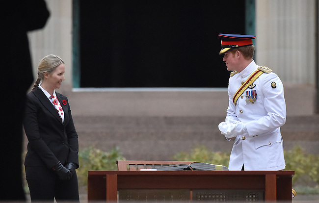 AUSTRALIA, Canberra : Captain Wales thanks the assistant during the  signing of the visitors book after laying a wreath at the Australian War Memorial, Canberra on 6 April 2015. AFP PHOTO / MARK GRAHAM