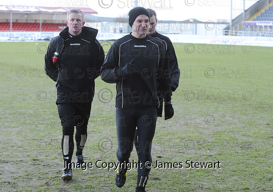 02/01/2010  Copyright  Pic : James Stewart.sct_jspa01_falkirk_v_st_johnstone  .:: REFEREE STEVIE O'REILLY CALLS THE GAME OFF  :: .James Stewart Photography 19 Carronlea Drive, Falkirk. FK2 8DN      Vat Reg No. 607 6932 25.Telephone      : +44 (0)1324 570291 .Mobile              : +44 (0)7721 416997.E-mail  :  jim@jspa.co.uk.If you require further information then contact Jim Stewart on any of the numbers above.........