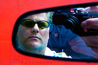 Self portrait in my rear-view mirror in Houston in 2010.