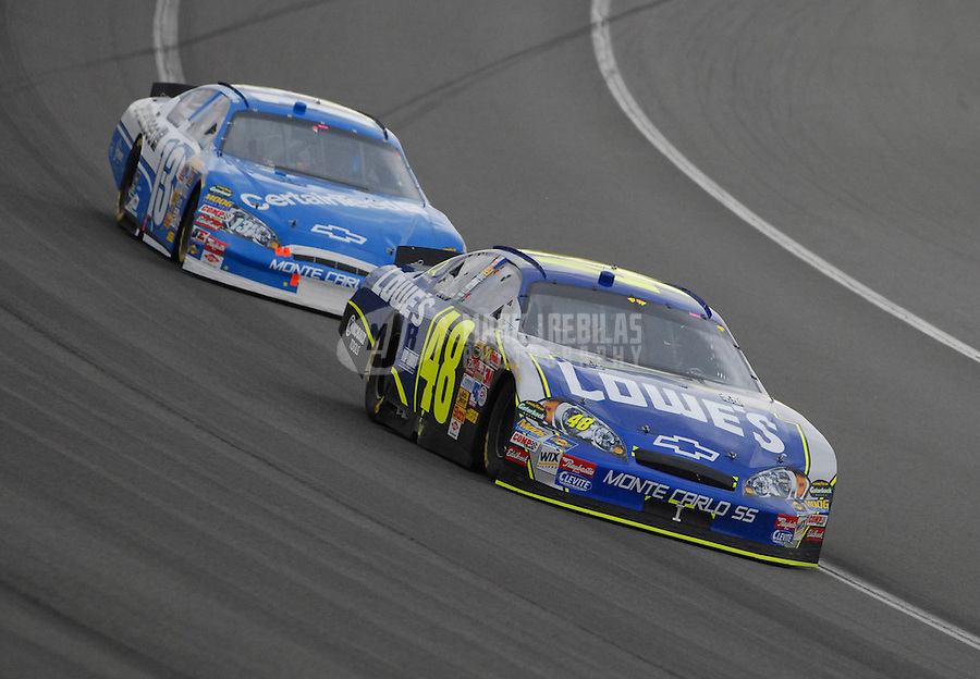 Feb 25, 2007; Fontana, CA, USA; Nascar Nextel Cup Series driver Jimmie Johnson (48) leads Joe Nemechek (13) during the Auto Club 500 at California Speedway. Mandatory Credit: Mark J. Rebilas