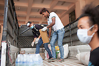 "A volunteer from ""I to We"" loading relief goods in a vehicle in Trauma center in Kathmandu, Nepal. May 05, 2015"