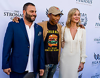HALLANDALE BEACH, FL - JANUARY 27: Belinda Stronach, Pharrell and Mark Grutman on the Blue Carpet on Pegasus World Cup Invitational Day at Gulfstream Park Race Track on January 27, 2018 in Hallandale Beach, Florida. (Photo by Scott Serio/Eclipse Sportswire/Getty Images)
