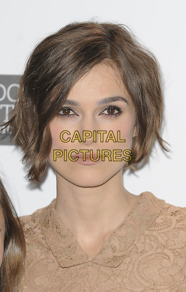 KEIRA KNIGHTLEY.Photocall ahead of the BFI London Film Festival screeening of 'Never Let Me Go', Vue West End, London, England..October 13th, 2010.headshot portrait beige lace .CAP/CAN.©Can Nguyen/Capital Pictures.