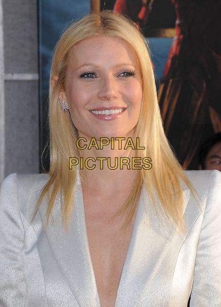 GWYNETH PALTROW.The Marvel World Premiere of Iron Man 2 held at The El Capitan Theatre in Hollywood, California, USA..April 26th, 2010      .headshot portrait white shiny jacket blazer black  smiling .CAP/RKE/DVS.©DVS/RockinExposures/Capital Pictures.