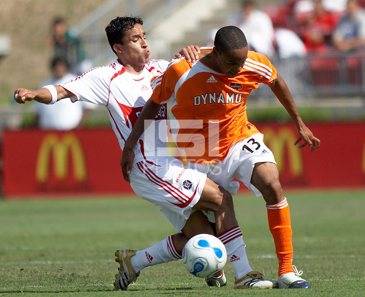 Chicago Fire's Ivan Guererro (23) attempts to steal the ball from Houston Dynamo's Ricardo Clark (13) at Robertson Stadium in Houston, TX on Saturday May 20, 2006. Chicago beat Houston 1-0.