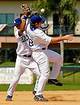 13 March 2007: Los Angeles Dodgers third baseman Andy La Roche (28, right) and shortstop Wilson Valdez (left) collide in the infield trying to field a pop fly by Detroit Tigers outfielder Cameron Maybin in the seventh inning at Holman Stadium in Vero Beach, Florida. La Roche was charged with a fielding error on the play. <br /> <br /> Mandatory Photo Credit: Ed Wolfstein Photo