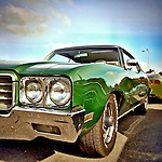 Green classic USA car form the 1970's with chrome fenders