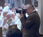 Long Island Catholic photographer Tom Moloney at Funeral Mass for The Most Reverend John R. McGann, Second Bishop of Rockville Centre, held at St. Agnes Cathedral, Rockville Centre on Monday Febrauary 4, 2002. (Newsday photo by Jim Peppler).