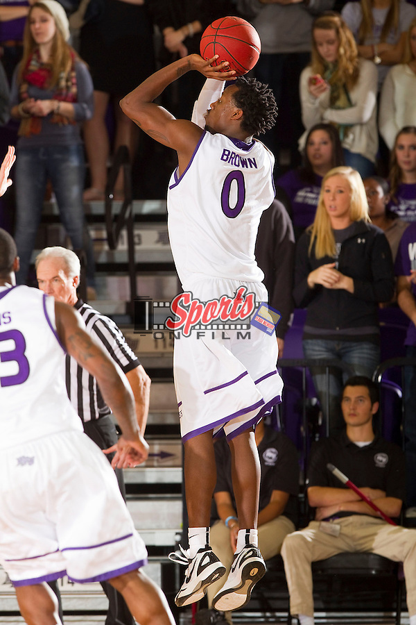 John Brown (0) of the High Point Panthers takes a jump shot during second half action against the UNCG Spartans at Millis Athletic Center on November 9, 2012 in High Point, North Carolina.  The Panthers defeated the Spartans 81-73.   (Brian Westerholt/Sports On Film)